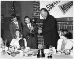 Julius deGive presents trophies at the Santa Claus Bowl banquet